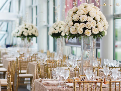 indoor wedding site with gorgeous flower centerpieces
