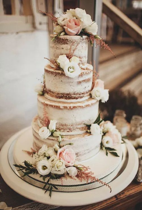 Four-Tiered Wedding Cake Topped With Flowers