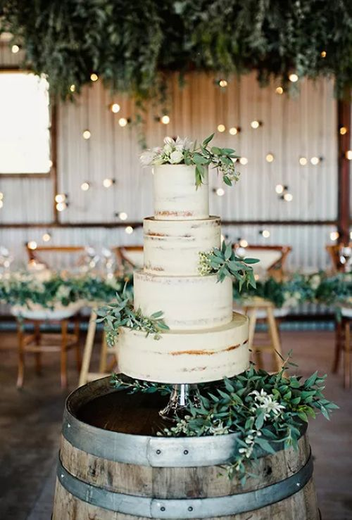 Four-Tiered Wedding Cake With Greenery