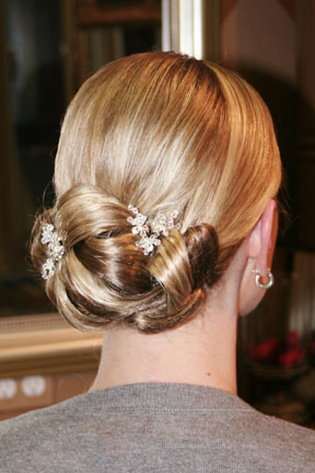 low updo with tight and elegant curls