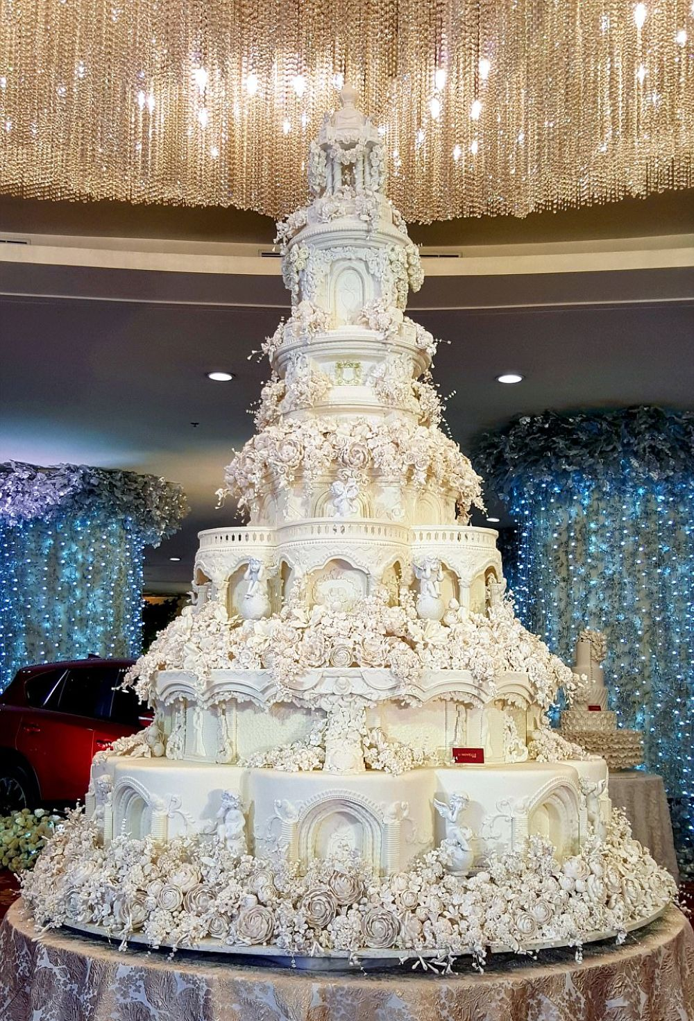 Castle Wedding Cake With Hundreds Of Individual Sugar Flowers