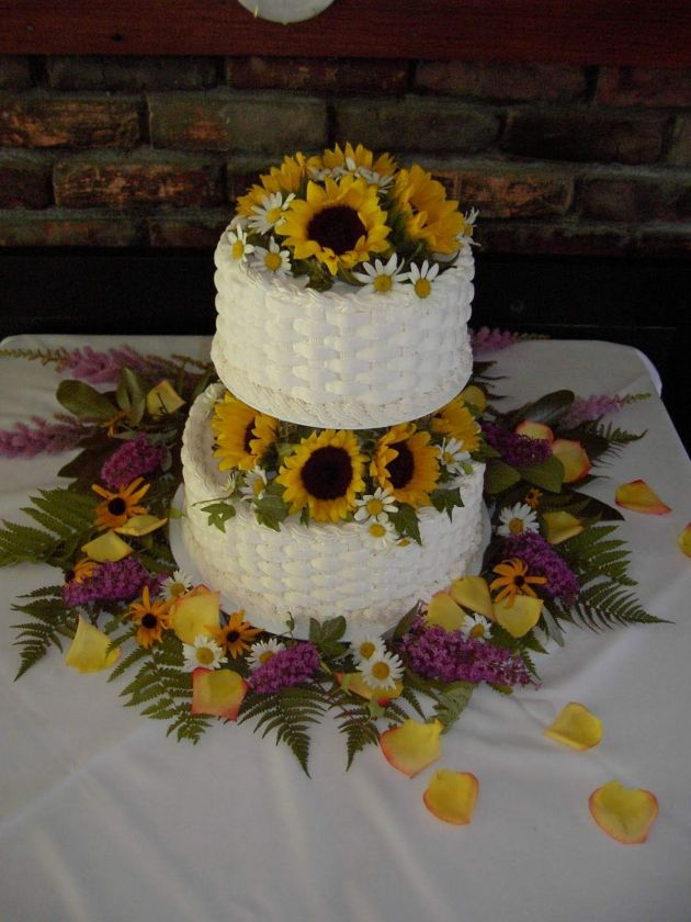 Two Tiered White Wedding Cake With Sunflowers