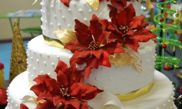 Christmas Wedding Cake With Red Flowers