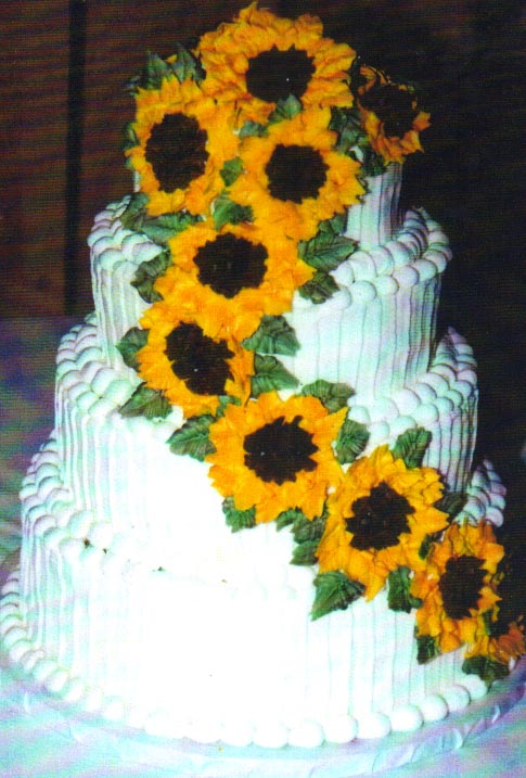 four tiers fresh sunflower wedding cake