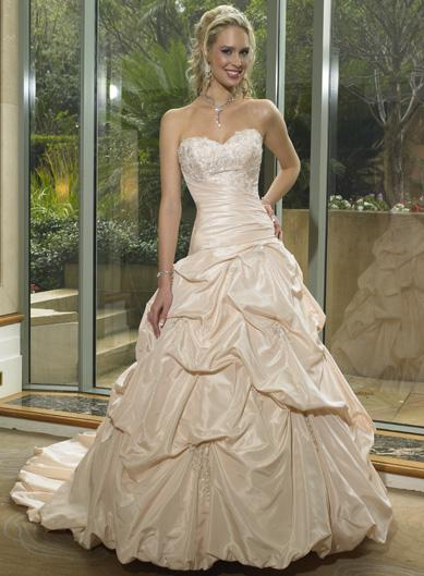 Evoking Your Elegance With Champagne Wedding Dresses