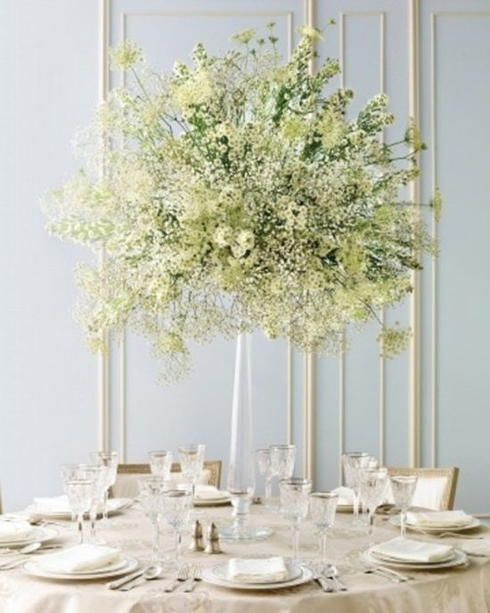 A Lush White Floral Centerpiece Of A Clear Vase