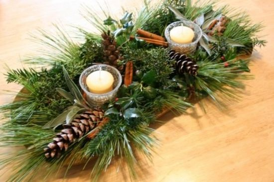 A Wooden Bowl With Evergreens Pinecones Cinnamon Sticks Candles And Fresh Greenery