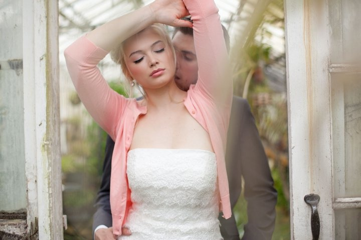 strapless white wedding dress with pink cardigan