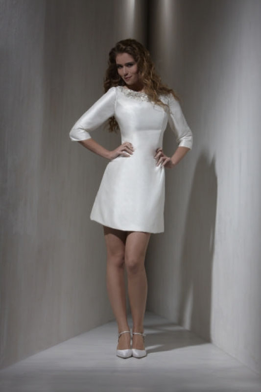 short white wedding dress with 34 sleeves it is available at wedding