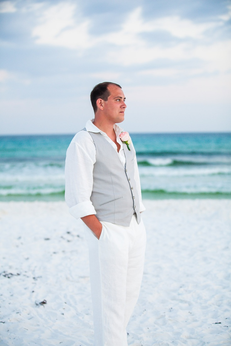 simple white beach wedding attire for groom