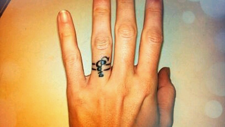 wedding ring tattoo with initial