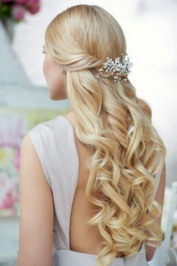 blond prom hair half up half down with floral accessory