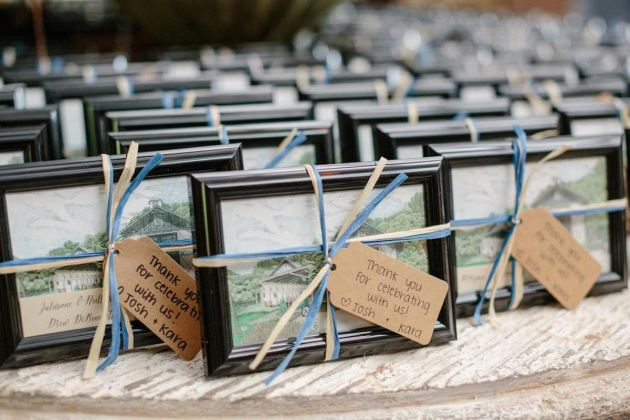 Small Framed Paintings Tied With Ribbon And Tags Wedding Favors