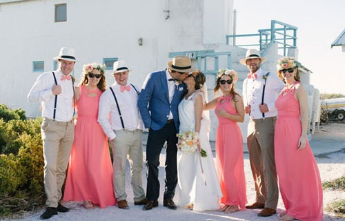 men beach wedding outfits with hat and bow