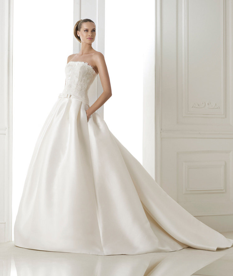 strapless wedding dress with pockets and bow