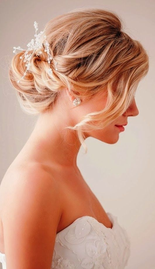 Low Twisted Chignon With A Rhinestone Hairpiece And A Long Bang