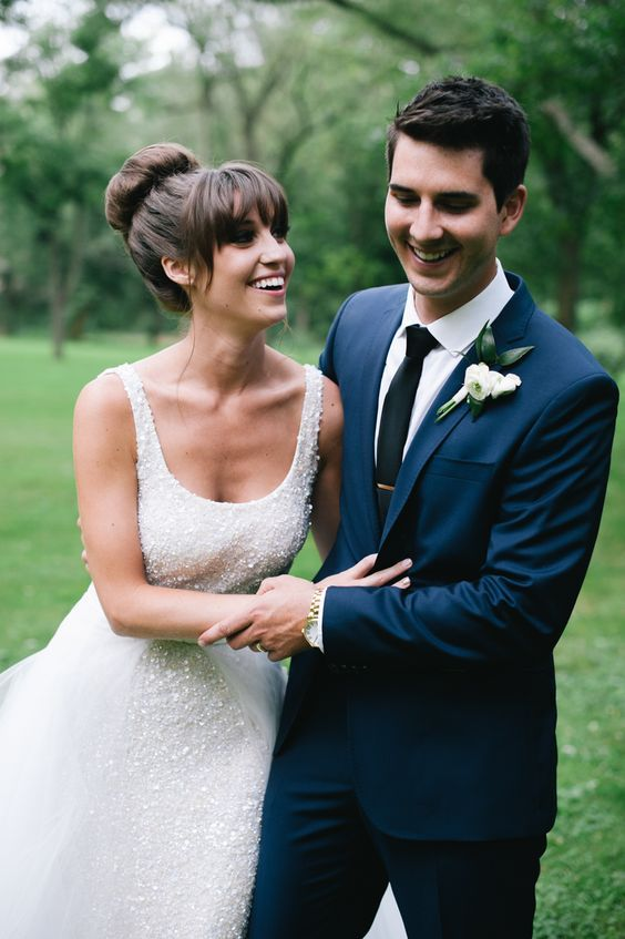 Top Knot And Much Volume And Bangs For An Elegant And Chic Bridal Look