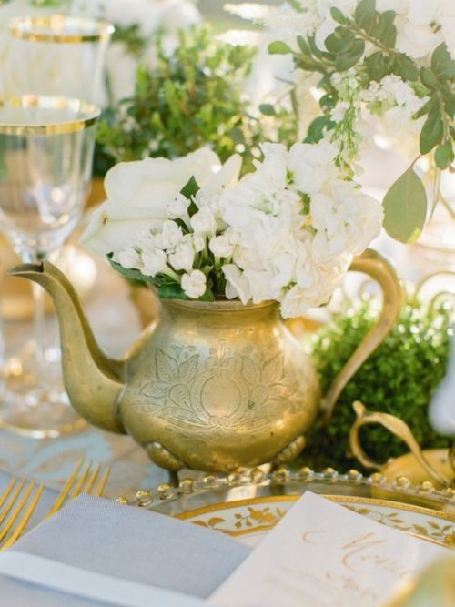 A Chic Vintage And Elegant Wedding Centerpiece With Gilded Teapot With Neutral Blooms And Greenery