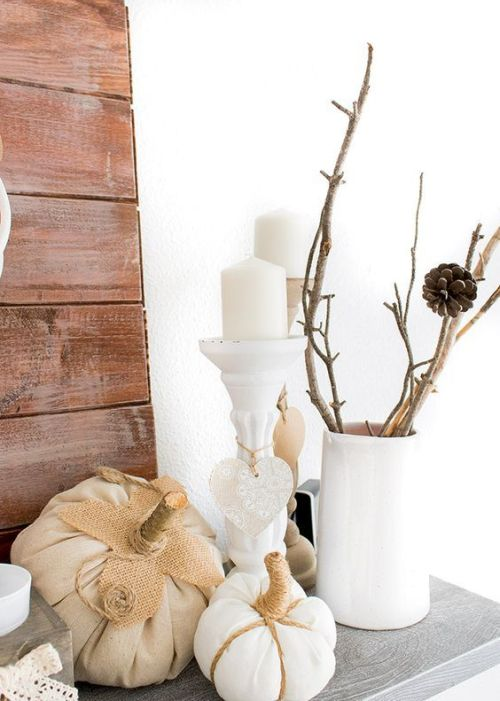 Fall Wedding Décor Idea With Branches In A White Vase And Some Faux White Pumpkins And Candles