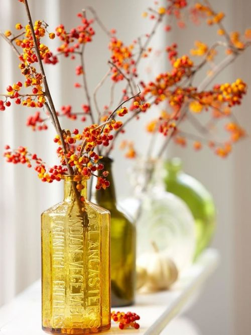 Fall Wedding Décor Idea With Branches With Bright Red Berries Put Into Fall-Colored Bottles And Vases