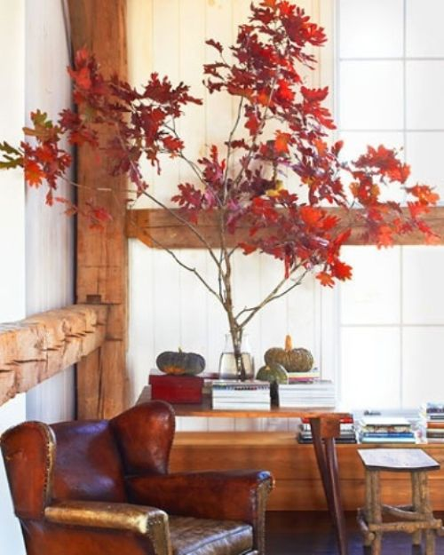 Fall Wedding Décor Idea With Branches With Bright Red Fall Leaves And A Couple Of Natural Pumpkins