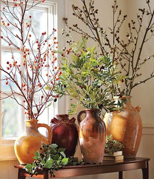 Fall Wedding Décor With An Antique-Inspired Vase With Branches And Yellow Leaves On Them