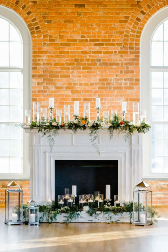 Faux Fireplace Wedding Backdrop With Greenery And Bold Blooms
