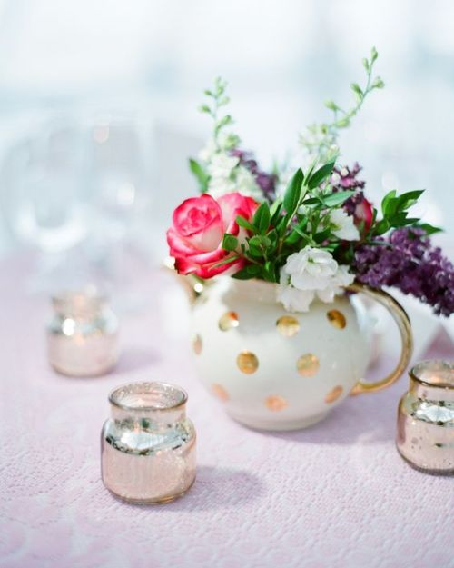 Gold Polka Dot Teapot With Pink Plus Purple And White Blooms And Silver Candle Holders