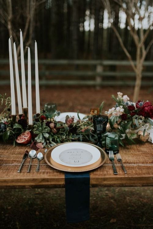 Halloween Wedding Table Setting Ideas With A Lush Moody Table Setting With A Table Runner With Blooms And Succulents And Pomegranates Plus Gilded Touches And Teal Napkins