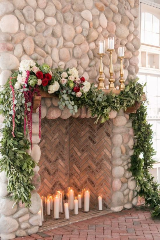 Large Fake Fireplace Wedding Backdrop With Lush Greenery
