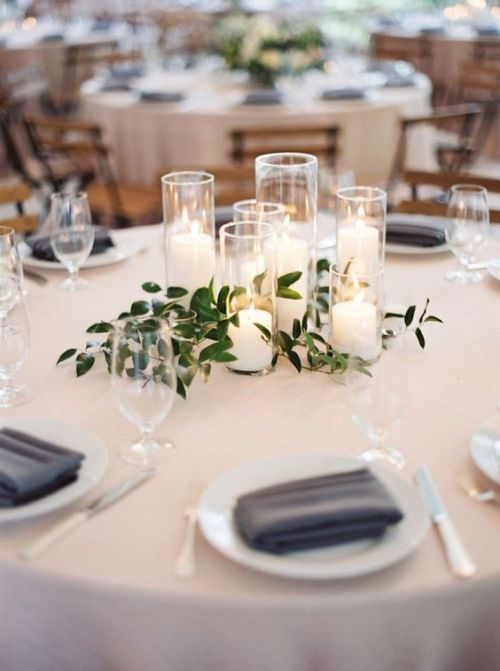 Minimalist Wedding Centerpiece Idea With A Group Of Candles With Greenery