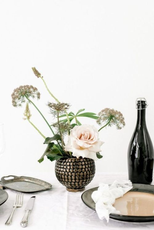 Minimalist Wedding Centerpiece Idea With A Very Catchy Embellished Round Vase With Some Dried Blooms And A Single Blush Roses
