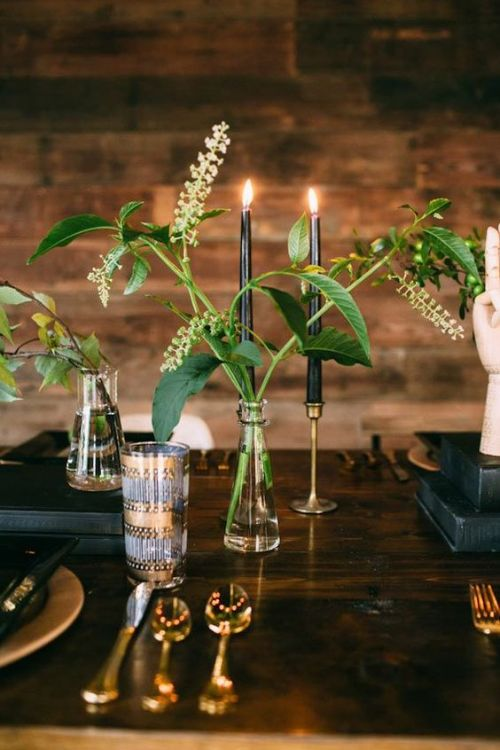 Minimalist Wedding Centerpiece Idea With Clear Vases With Greenery And Black Candles