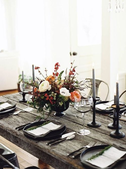 Rustic Halloween Tablescape With A Raw Weathered Wood Table Plus Grey Candles And Black Chargers And A Textural Floral Centerpiece