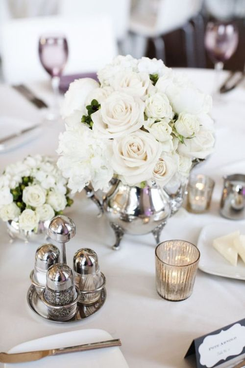 Silver Teapot With White Roses And Mercury Glass Candle Holders For Pure Elegance
