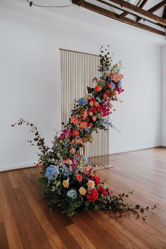 Striking Indoor Wedding Backdrop Of A Wooden Plank Stand And A Lush Floral Installation