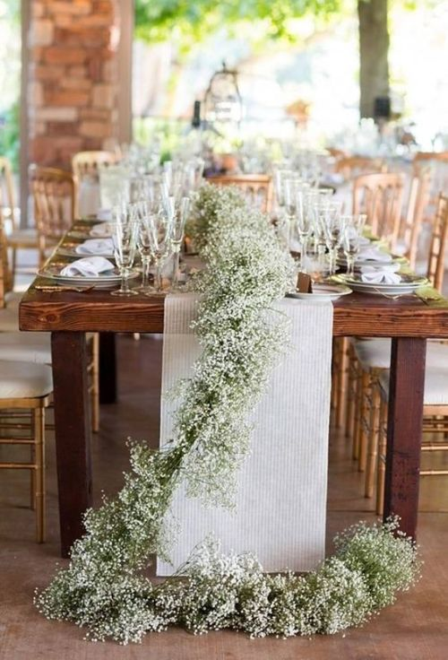 Striped Fabric Table Runner And A Baby's Breath One Combined For A Refined Rustic Touch