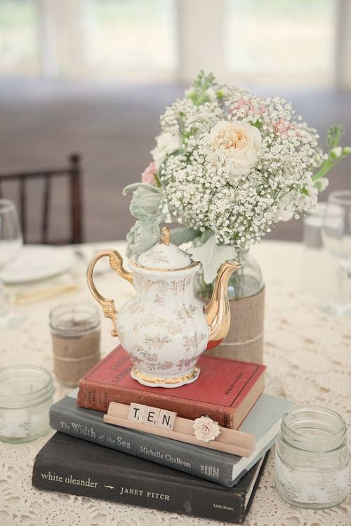 Vintage Books And A Vintage Floral Teapot With A Vase With Baby's Breath And Blush And Pink Blooms