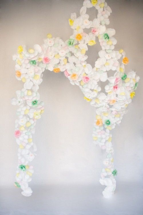 Wedding Arch Made Of White Green Yellow And Red Paper Flowers
