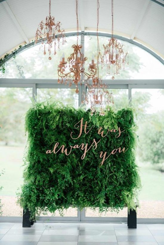 Wedding Backdrop With Lush Greenery Wall With A Quote In Copper Letters And Refined Copper Chandeliers