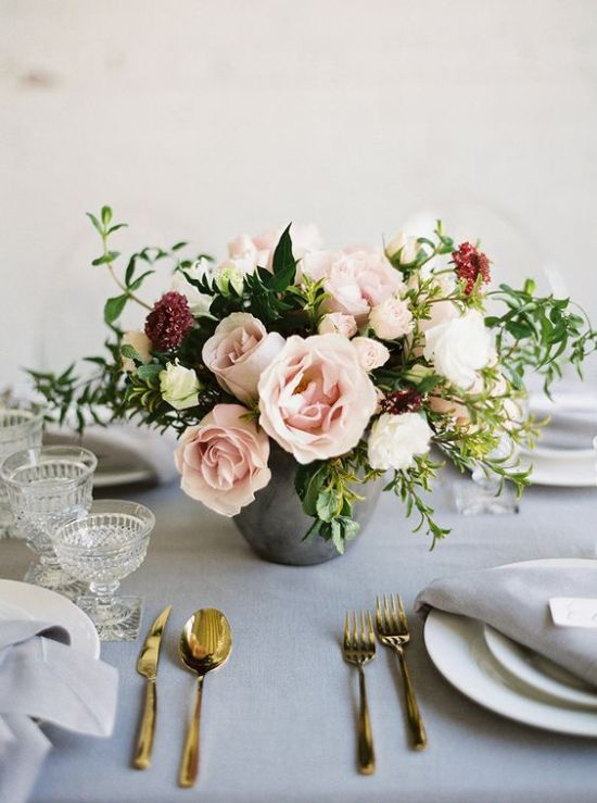 A Concrete Wedding Vase With Lush Blush Flowers Plus Greenery And Burgundy Touches