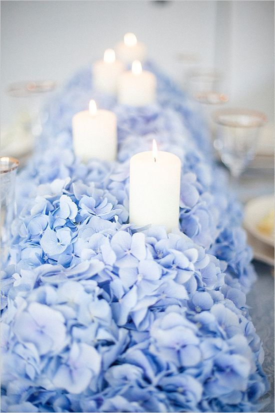A Lush Blue Hydrangea Table Runner Dotted With Candles Looks Very Impressive