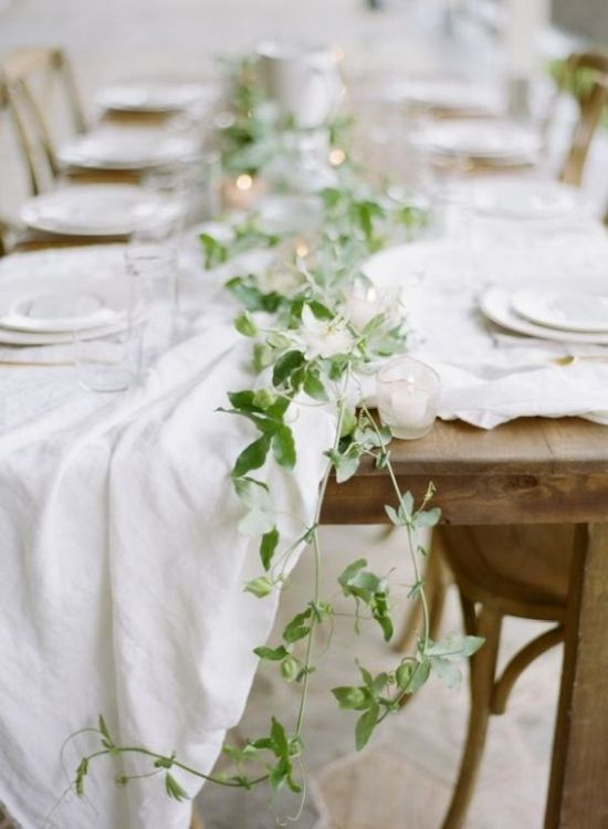 A Subtle Fresh Greenery Table Runner And Some Candles To Add Charm To The Table