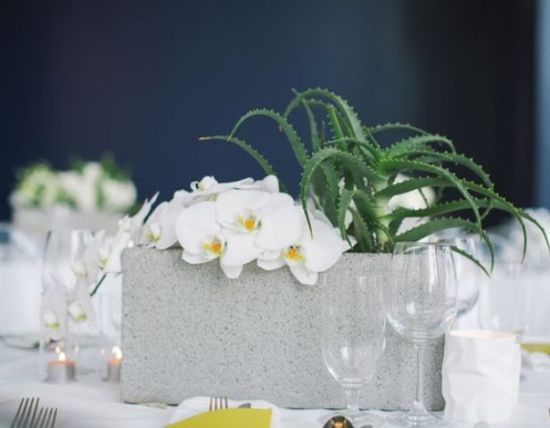 Cinder Block Wedding Centerpiece With A Succulent And White Orchids