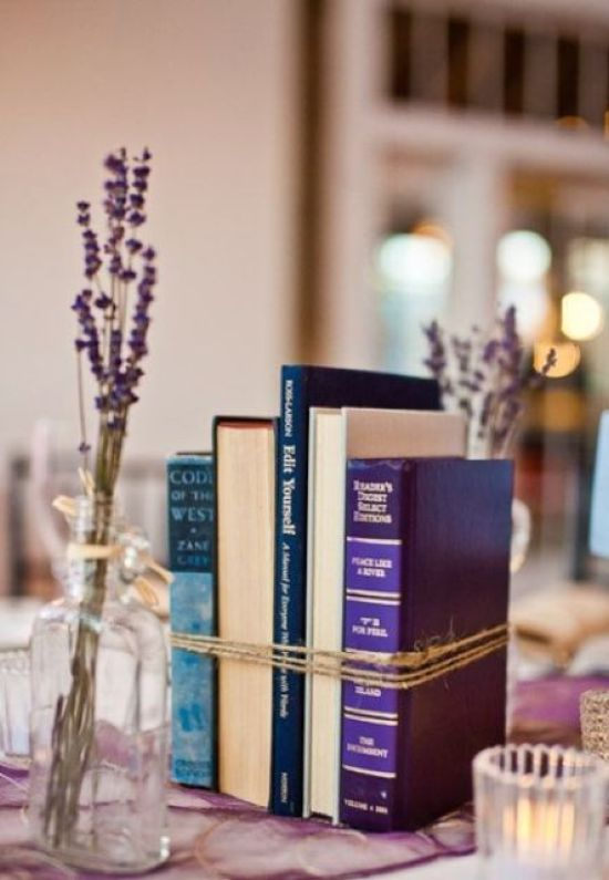 Simple And Stylish Wedding Centerpiece Idea With A Bundled Books Centerpiece And Some Candles Plus Lavender In Bottles Around