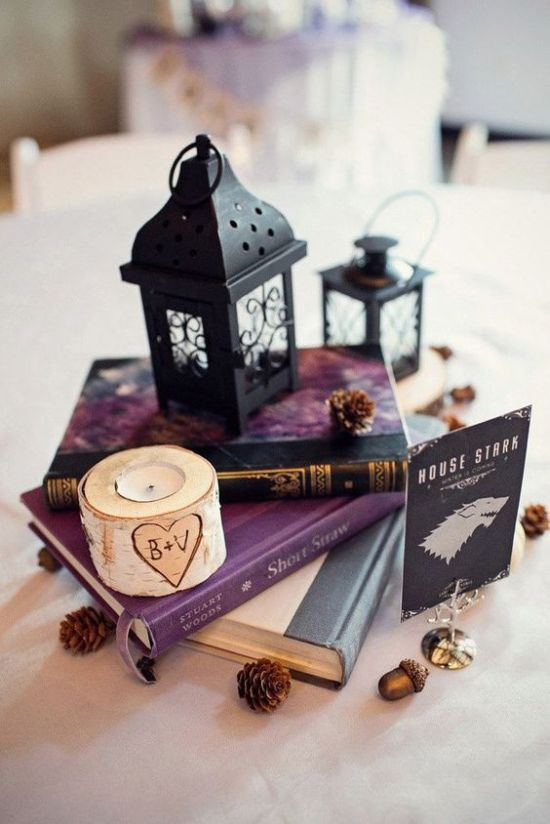 Vintage Book Wedding Centerpiece With Small Black Lanterns And Pinecones And A Birch Candle Holder