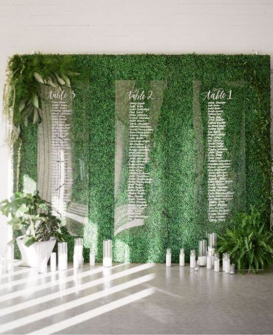 Wedding Seating Plan Idea With Acrylic Slabs On A Leafy Backdrop