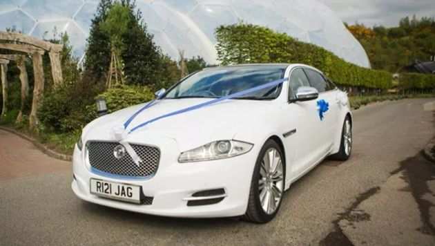 Jaguar Wedding Car Decor With Blue Ribbons