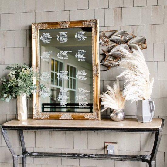 Wedding Seating Plan Idea With Mirror Framed In Gold With Pampas Grass