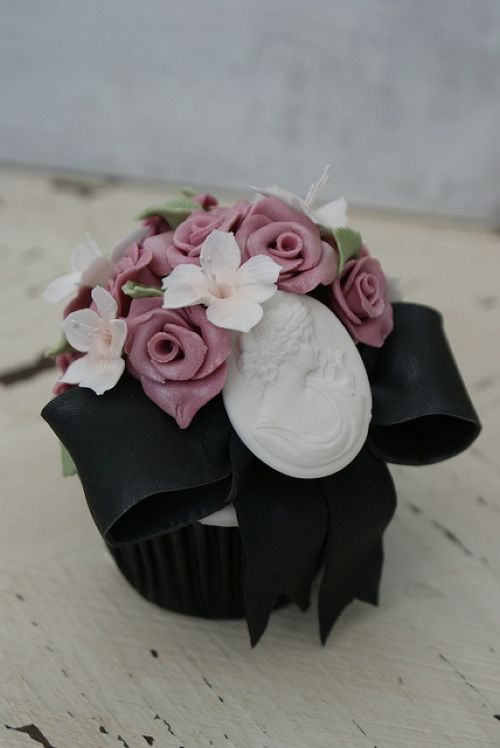 Black Wedding Cake With White And Purple Edible Flowers